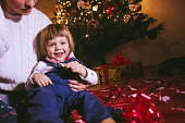 Little Boy Smiling Next to Christmas Tree