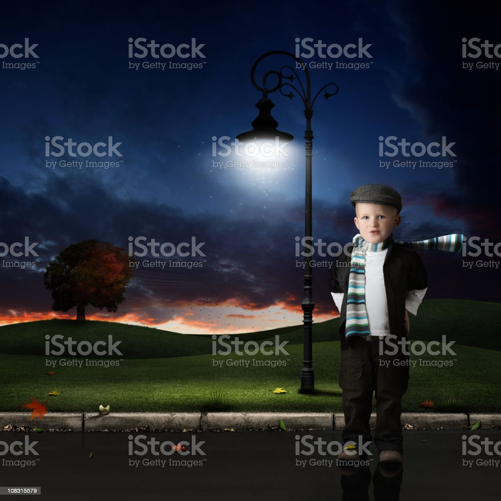 Little boy standing outside in a hat stock photo