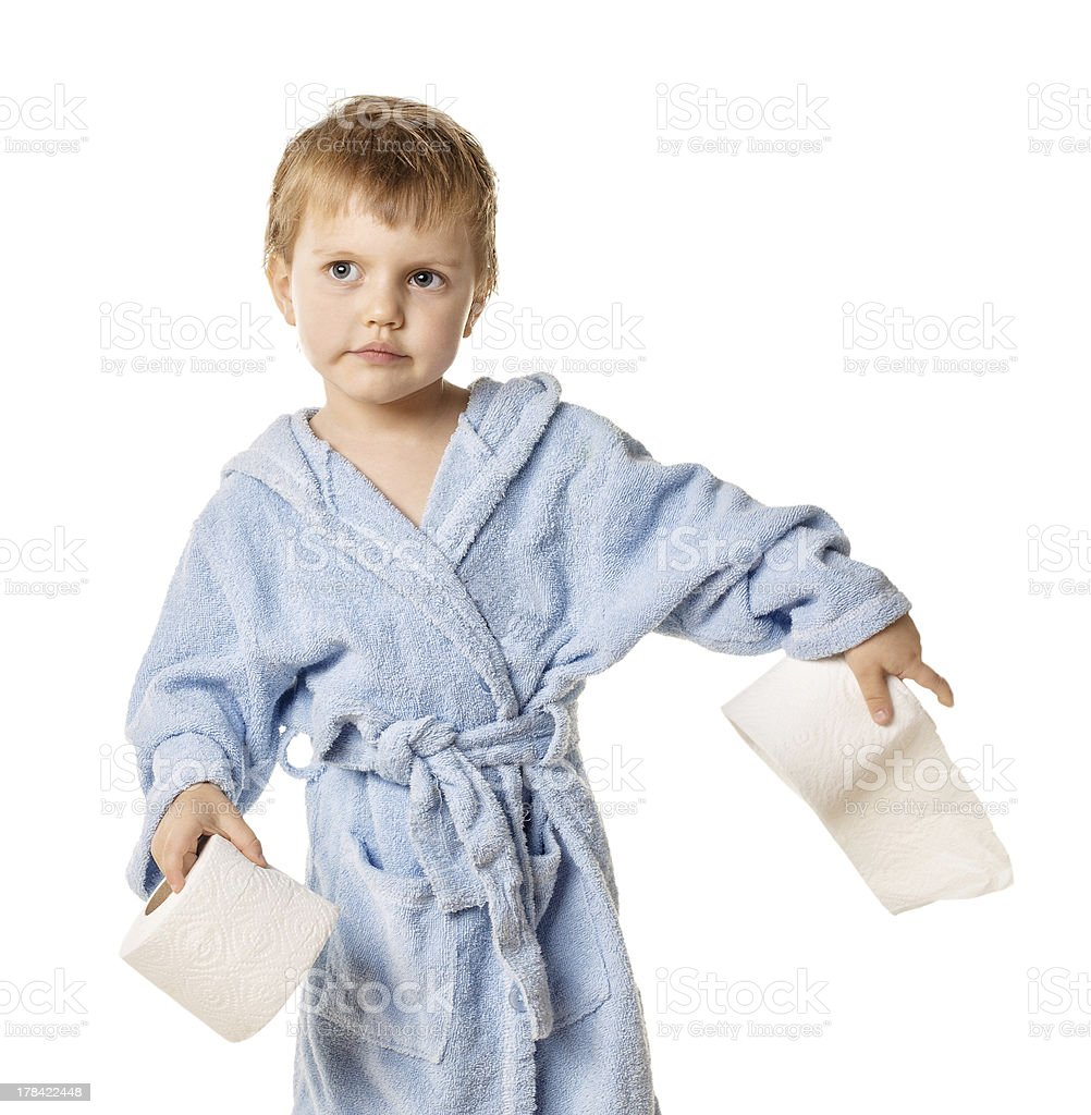 little boy standing with roll of toilet paper stock photo