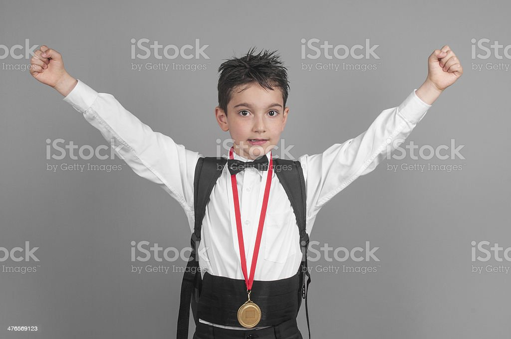 Little boy student with medal royalty-free stock photo