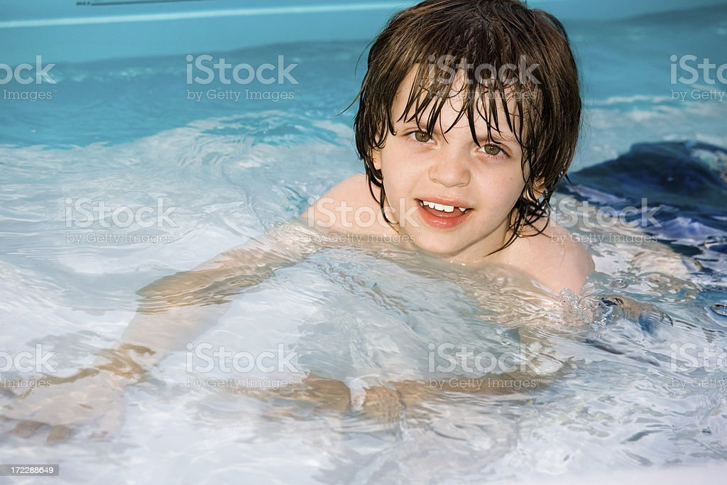 Little Boy Swimming in a Pool royalty-free stock photo