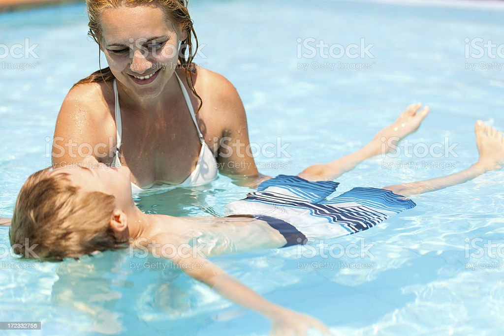 Little boy swimming in the pool royalty-free stock photo