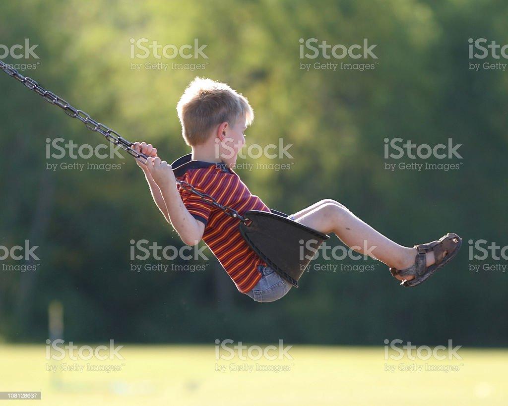 Little Boy Swinging on Park royalty-free stock photo