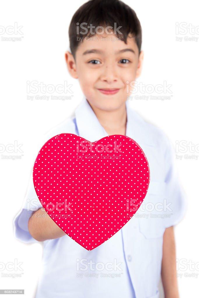 Little boy taking heart shape pretent as doctor stock photo