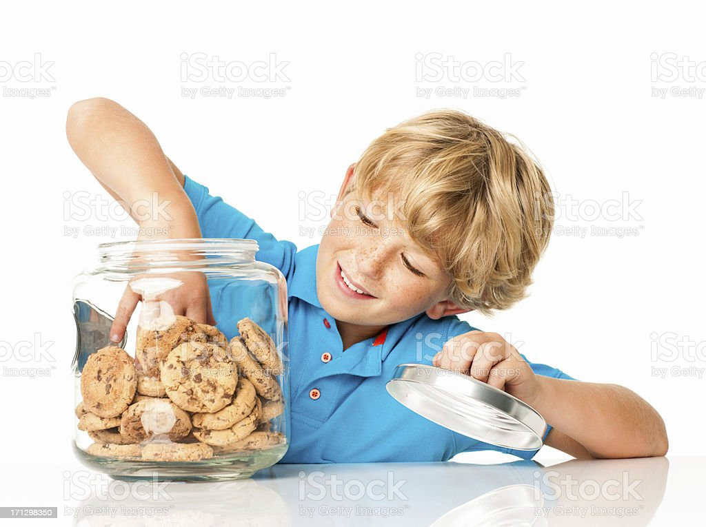 Little Boy Taking Out Chocolate Chip Cookie - Isolated royalty-free stock photo