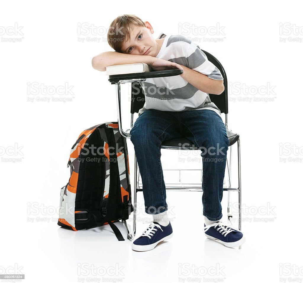 Little boy taking rest on chair stock photo