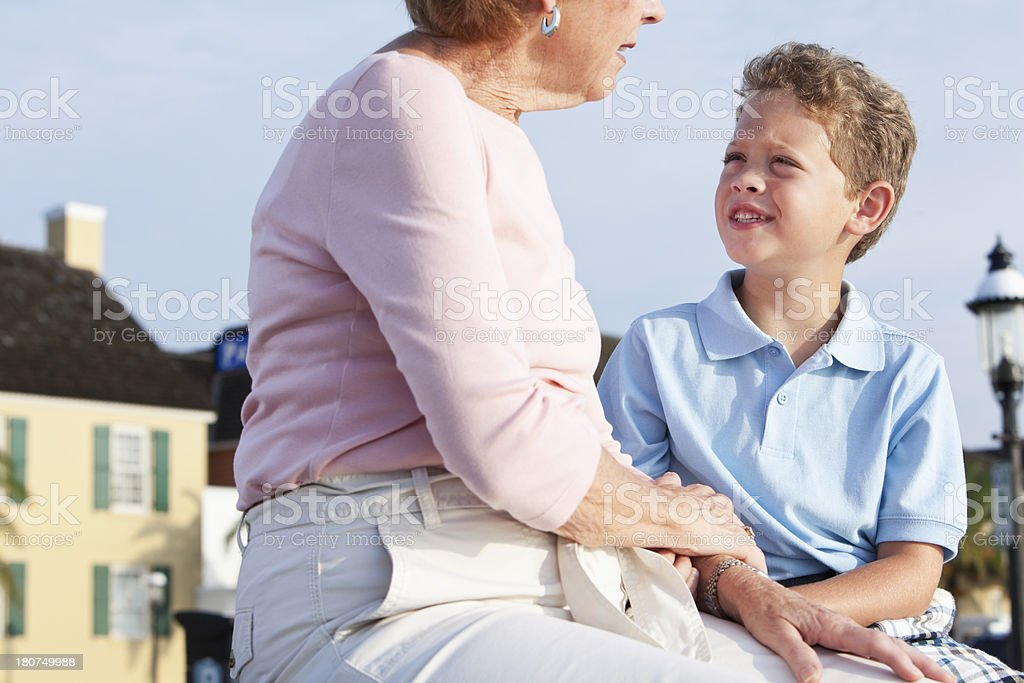Little boy talking to grandmother royalty-free stock photo