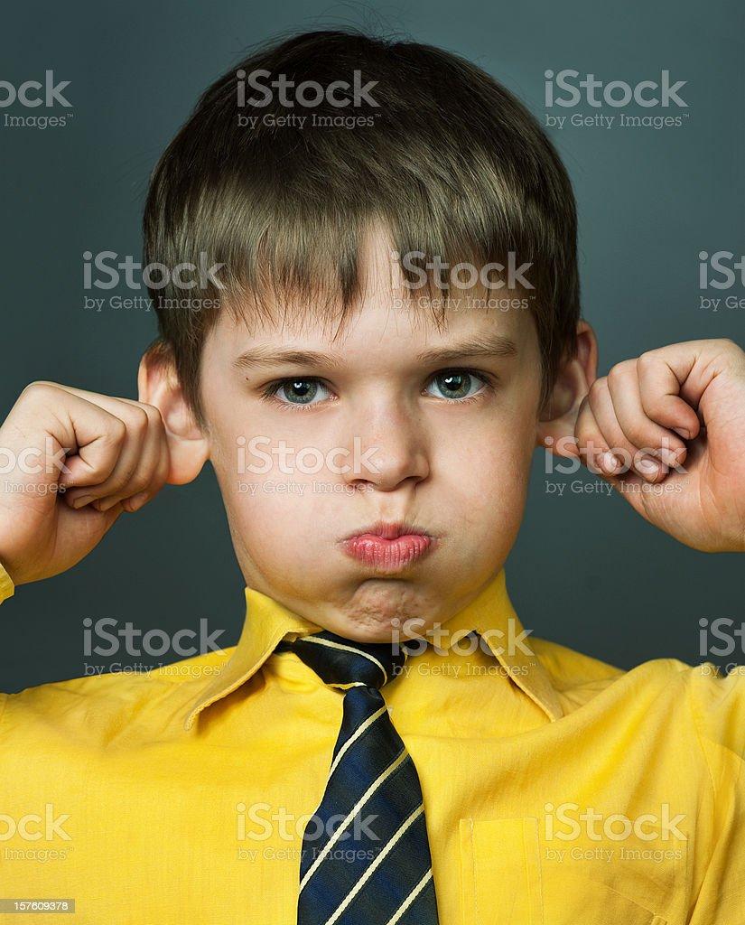 Little boy teases stock photo