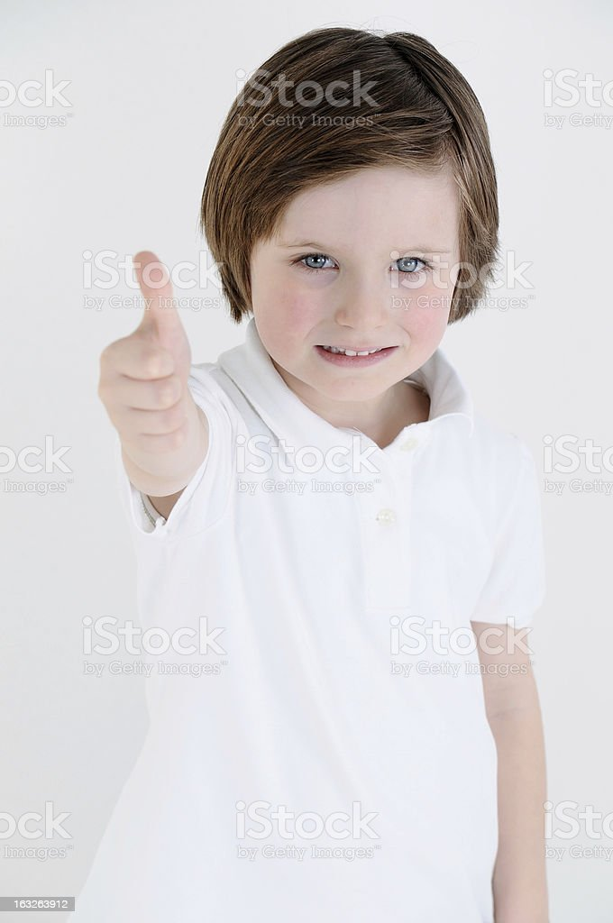 Little boy thumbs up royalty-free stock photo