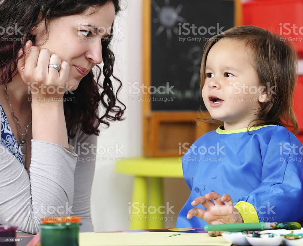 Little Boy/ Toddler Talking To His Carer/ Parent stock photo