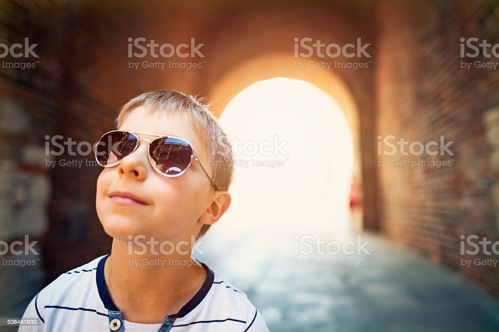 Little boy tourist visiting medieval town - Lublin, Poland stock photo