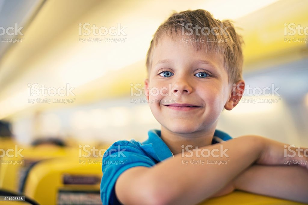 Little boy travelling in plane stock photo