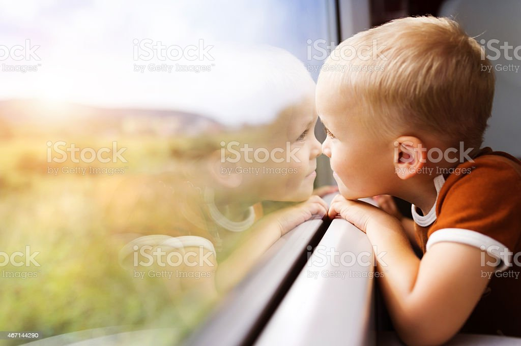Little boy travelling in train stock photo