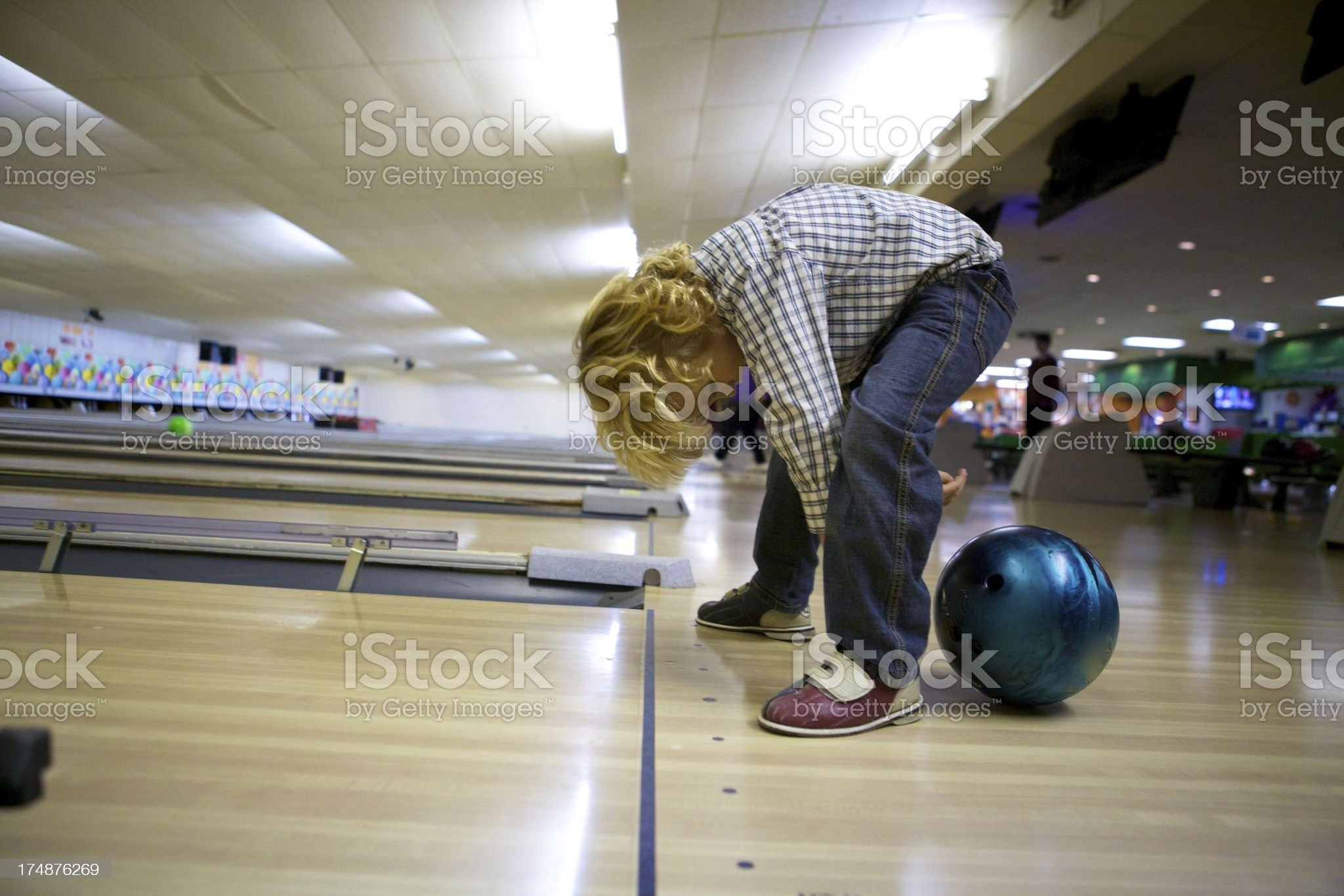 Little Boy Trying to Bowl royalty-free stock photo