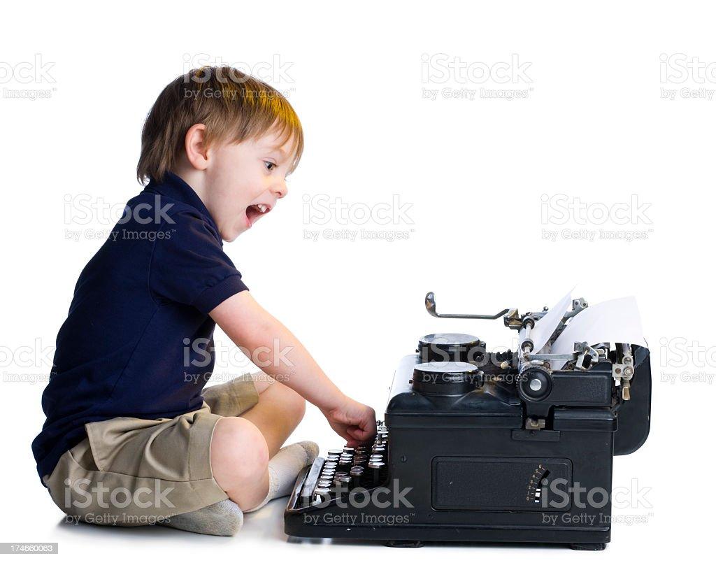 Little Boy Typing on Old Typewriter royalty-free stock photo