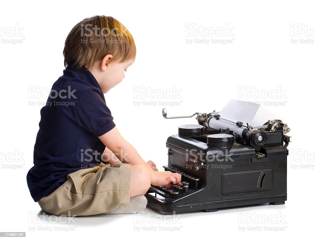 Little Boy Typing on Old Typewriter royalty-free stock photo