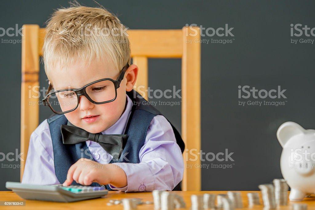 Little Boy Using a Calculator stock photo