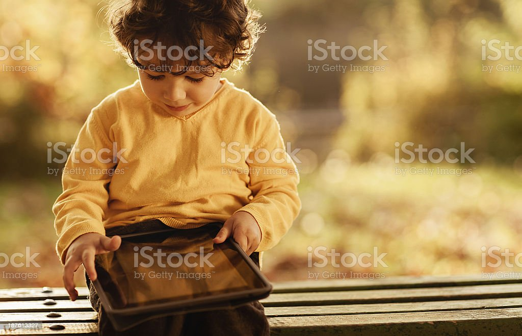 Little boy using digital tablet royalty-free stock photo