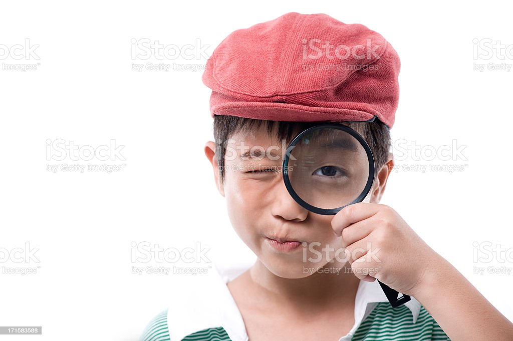 Little boy using magnifying glass royalty-free stock photo