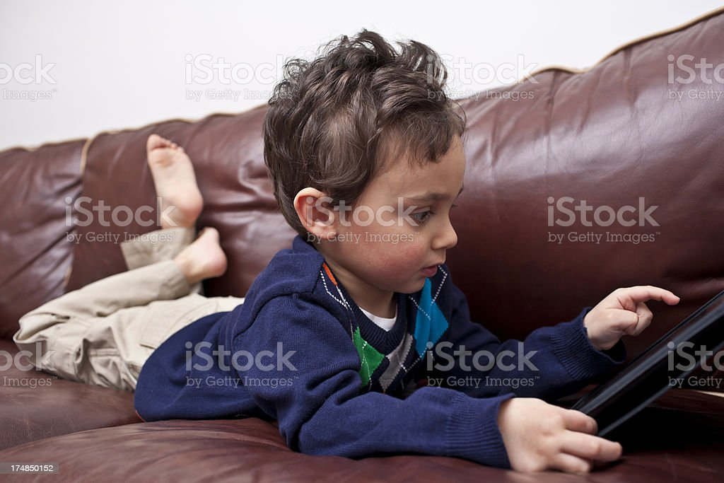 Little boy using tablet computer royalty-free stock photo