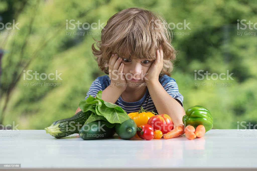 Little boy vegetable meal stock photo