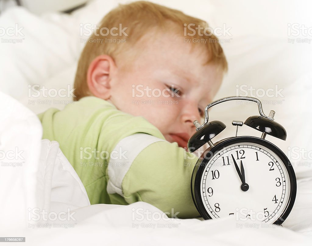 Little Boy Wake up with alarm clock royalty-free stock photo