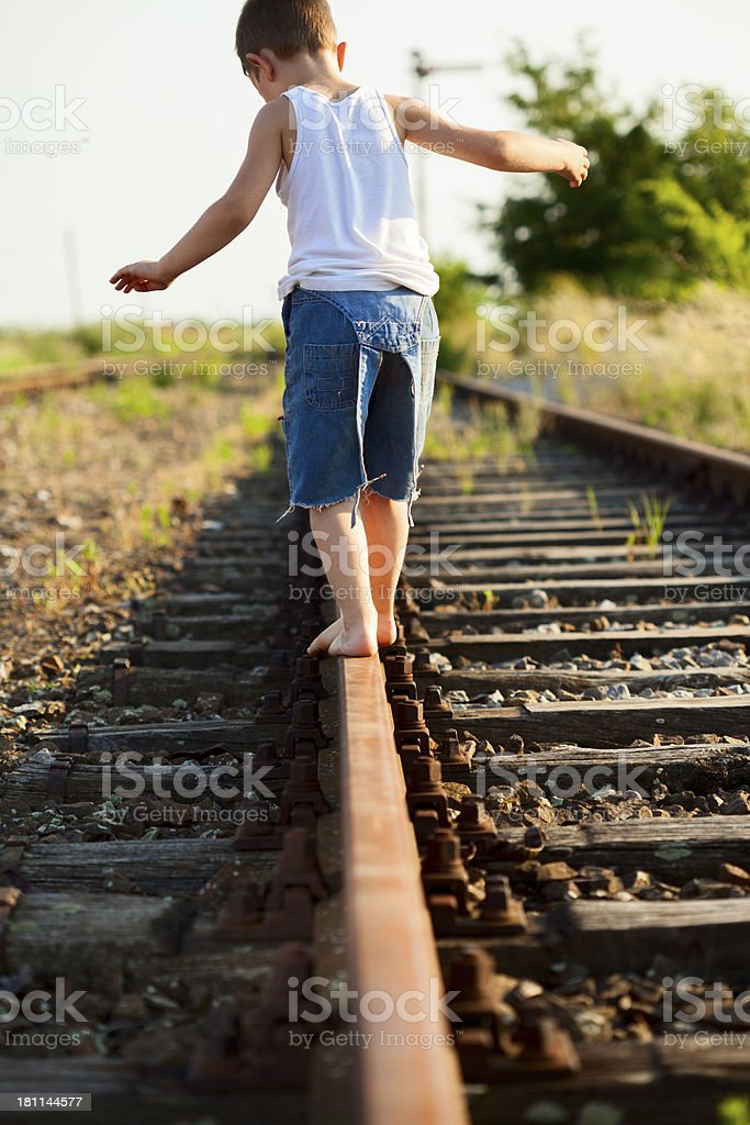 Little boy walking down train track royalty-free stock photo