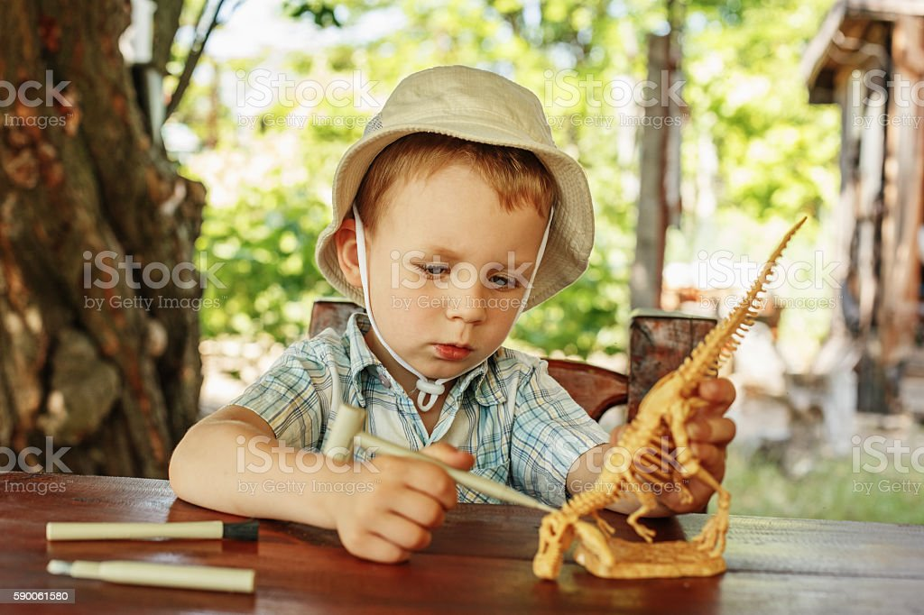 little boy wants to be an archaeologist stock photo