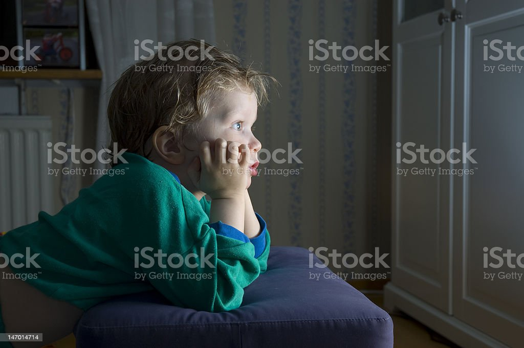 Little boy watching TV stock photo
