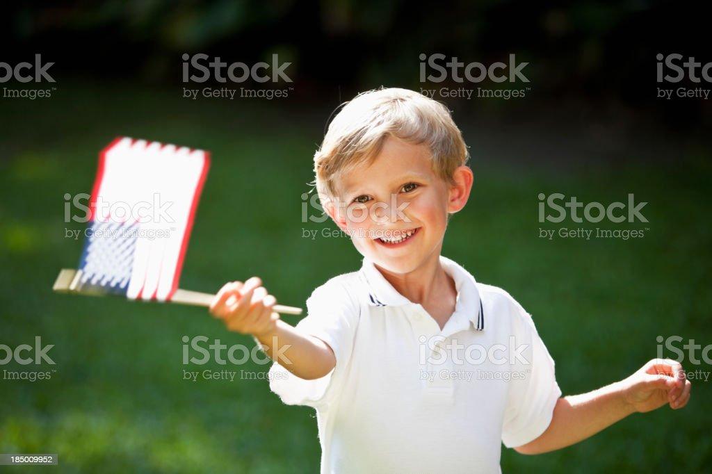 Little boy waving mini American flag stock photo
