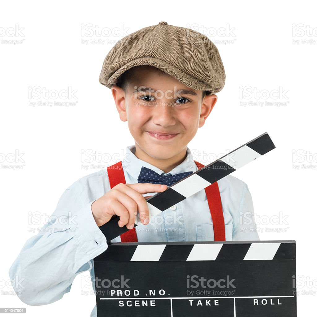 Little Boy Wearing Newsboy Cap Posing With Film Slate stock photo