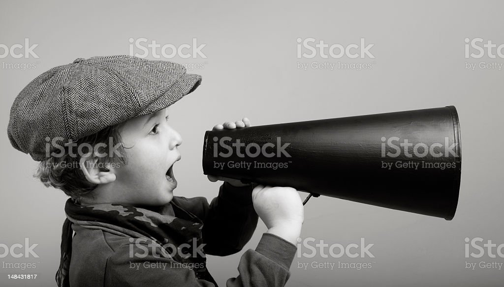 Little Boy Wearing Newsboy Cap Shouting On Old Fashioned Megaphone stock photo