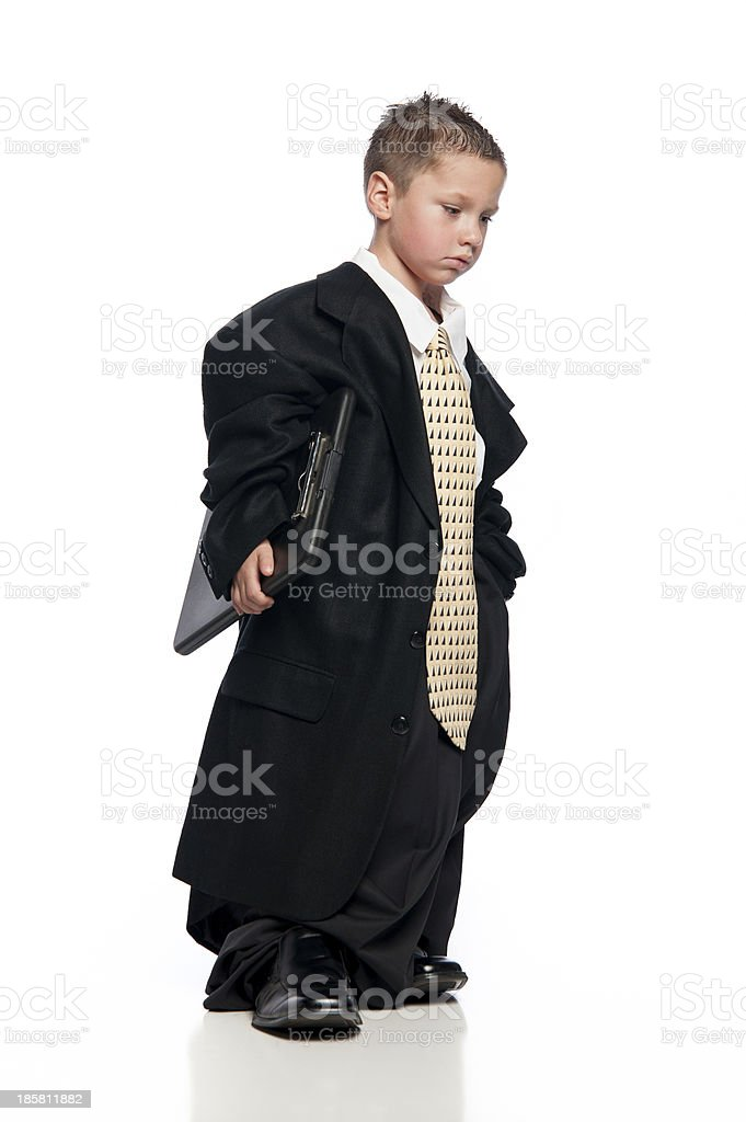 Little Boy Wearing Oversized Suit Holding Clip Board Under Arm royalty-free stock photo