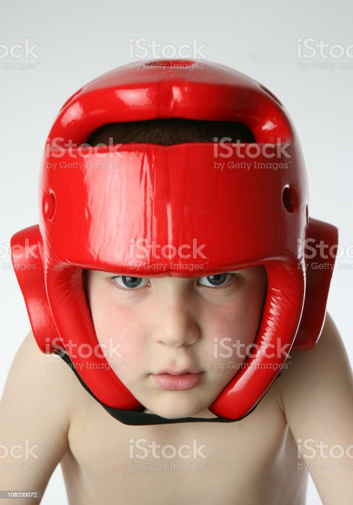 Little Boy Wearing Protective Boxing Head Gear royalty-free stock photo