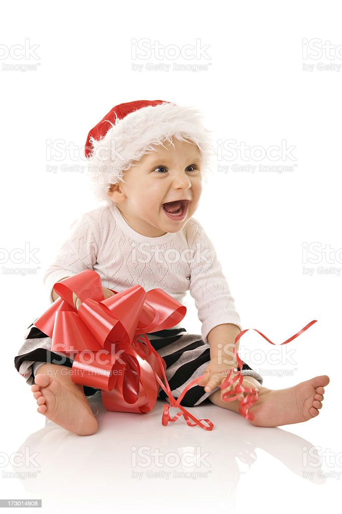Little boy wearing Santa hat and holding a bow royalty-free stock photo