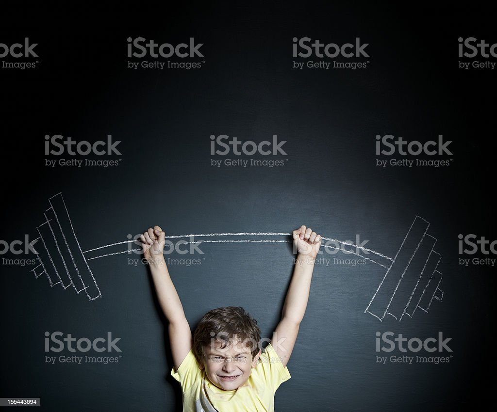 Little boy weight lifter stock photo