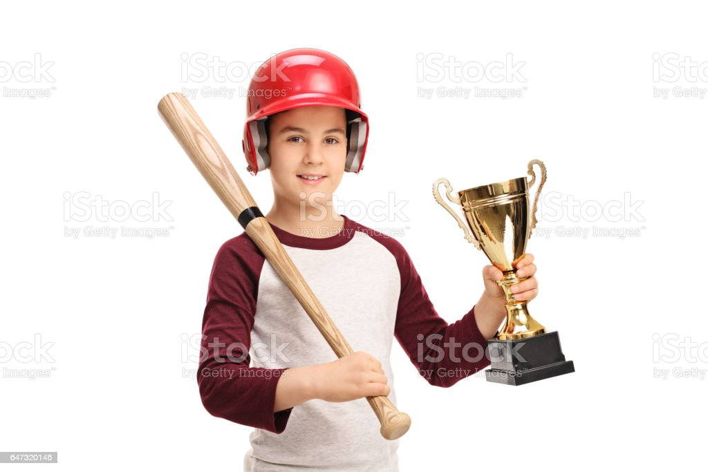 Little boy with a baseball bat and a golden trophy stock photo