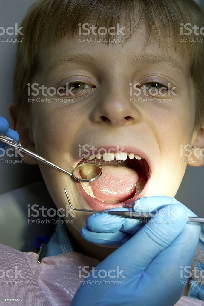 little boy with a doctor in dental surgery royalty-free stock photo