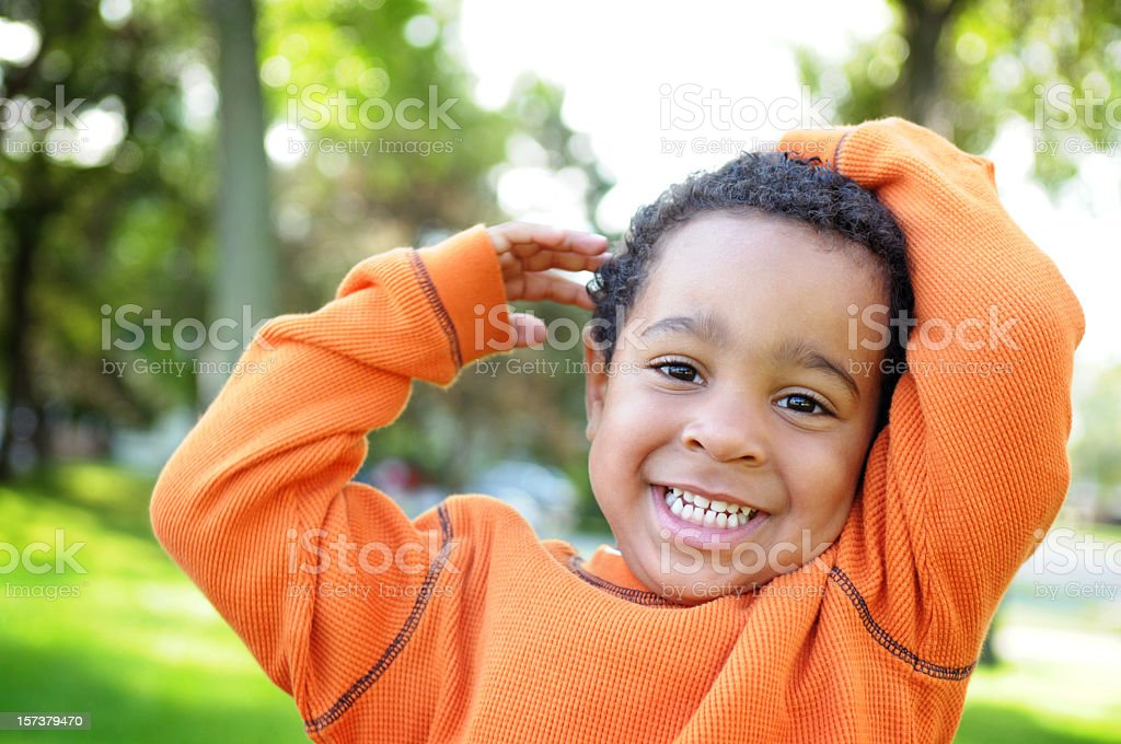 Little Boy with a Priceless Smile Outside stock photo