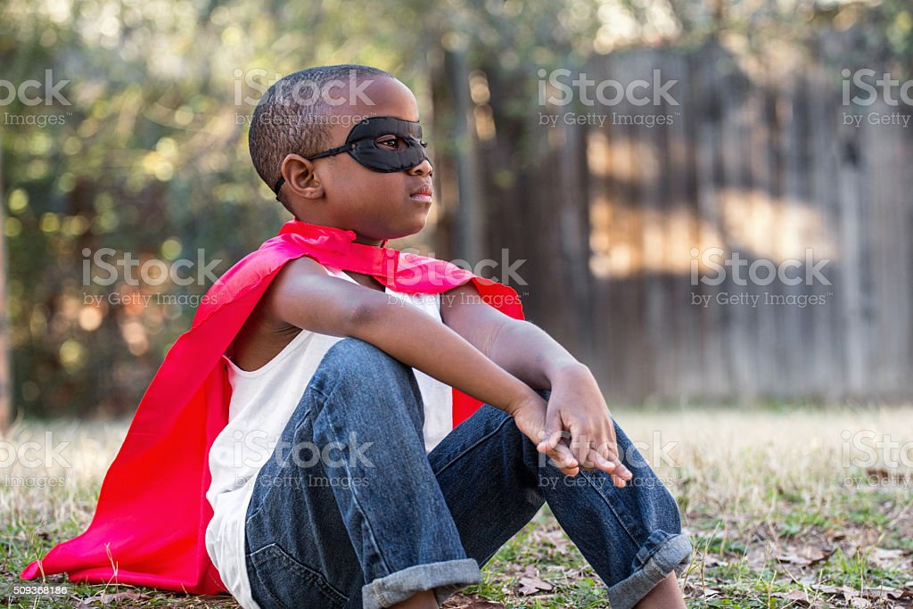 Little boy with a red super hero  cape. stock photo