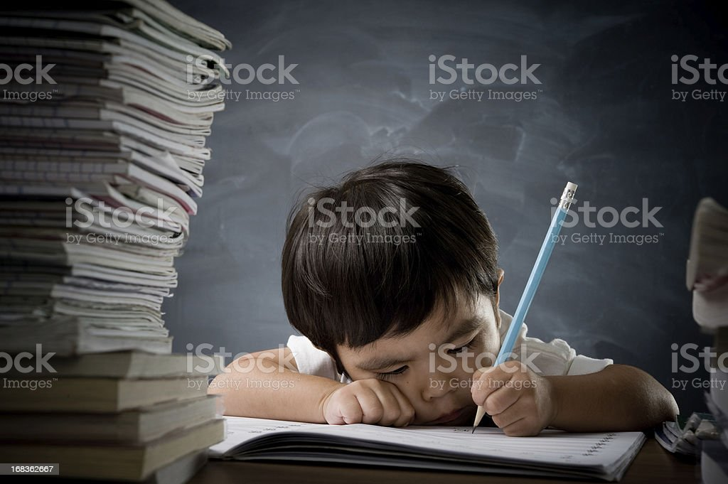 Little boy with a stack of books royalty-free stock photo