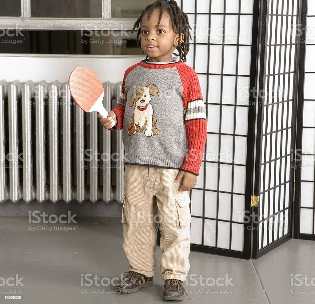 Little boy with a table tennis bat royalty-free stock photo