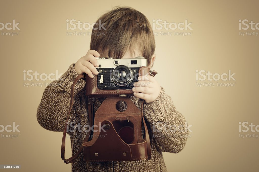 Little boy with an old camera stock photo