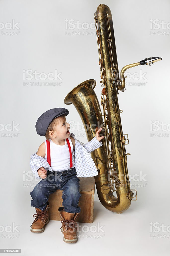 little boy with an old saxophone stock photo