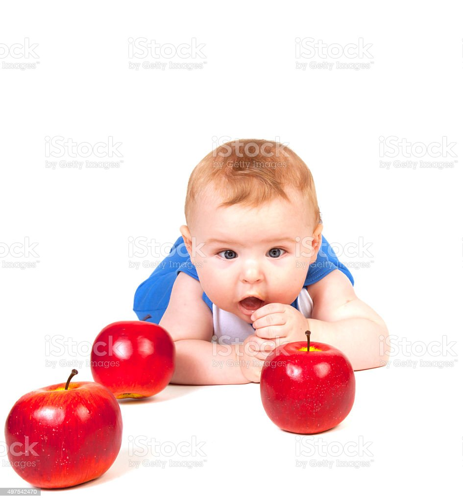 Little boy with apples. stock photo