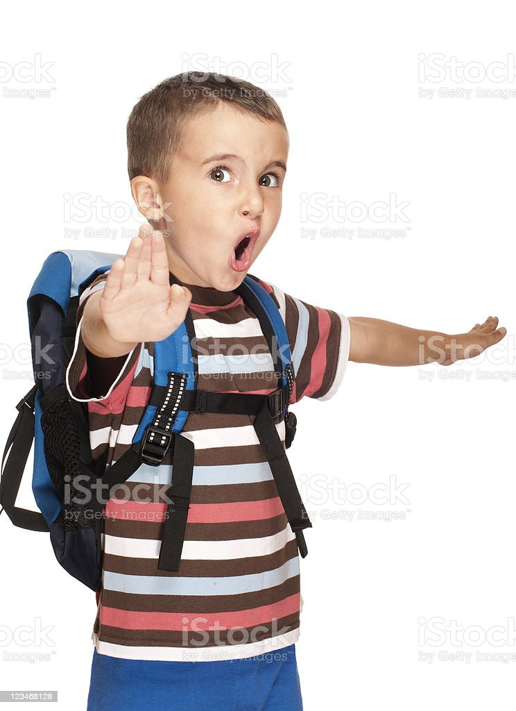 Little boy with backpack pretends kung-fu stock photo
