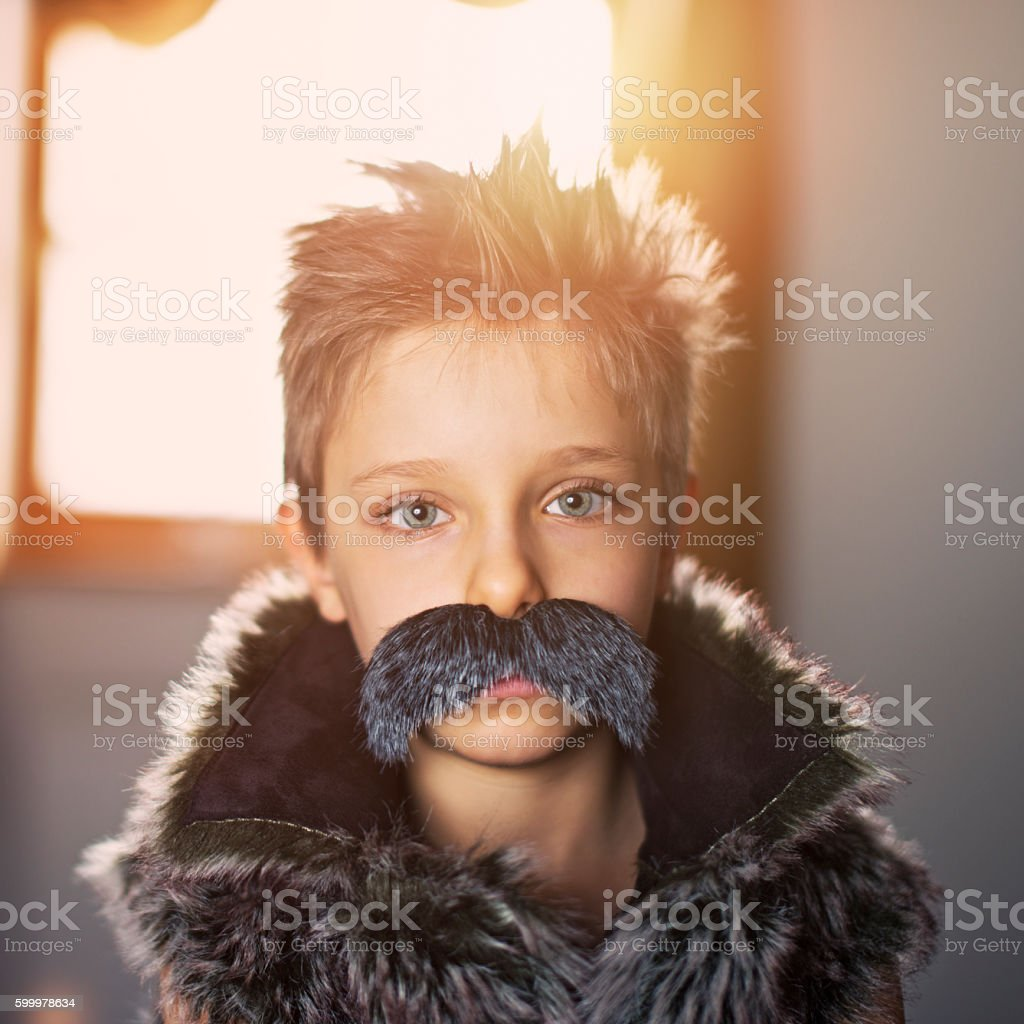 Little boy with big moustache stock photo