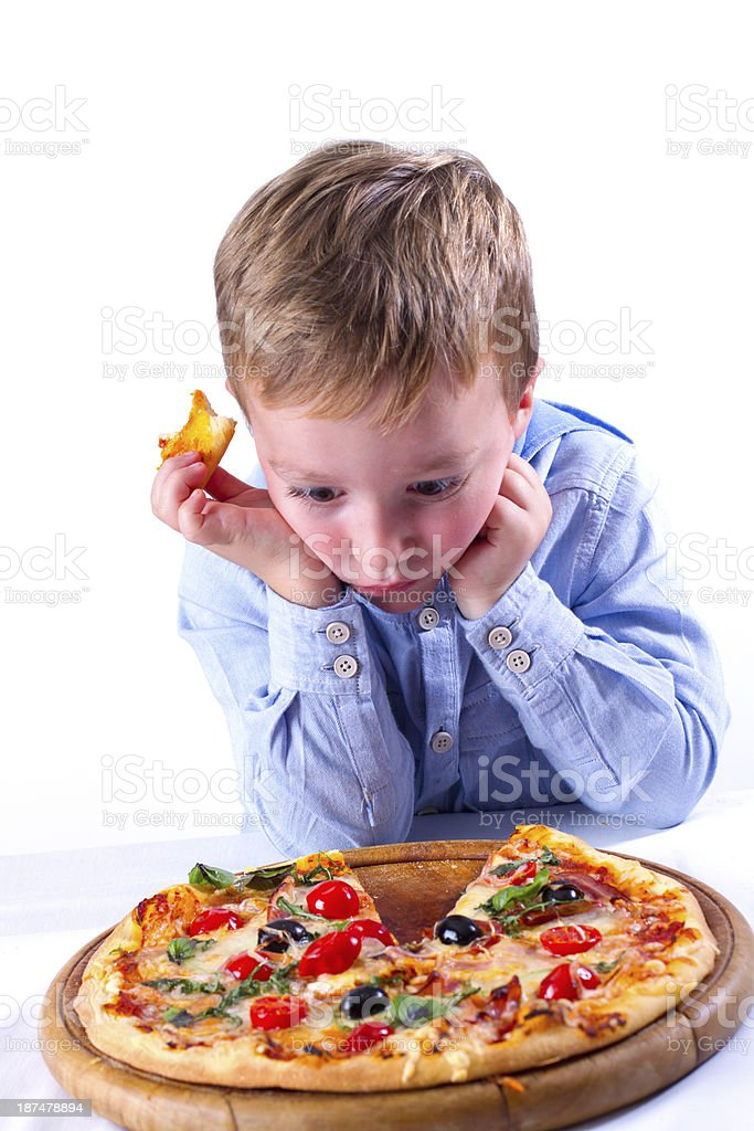 Little boy with big pizza royalty-free stock photo