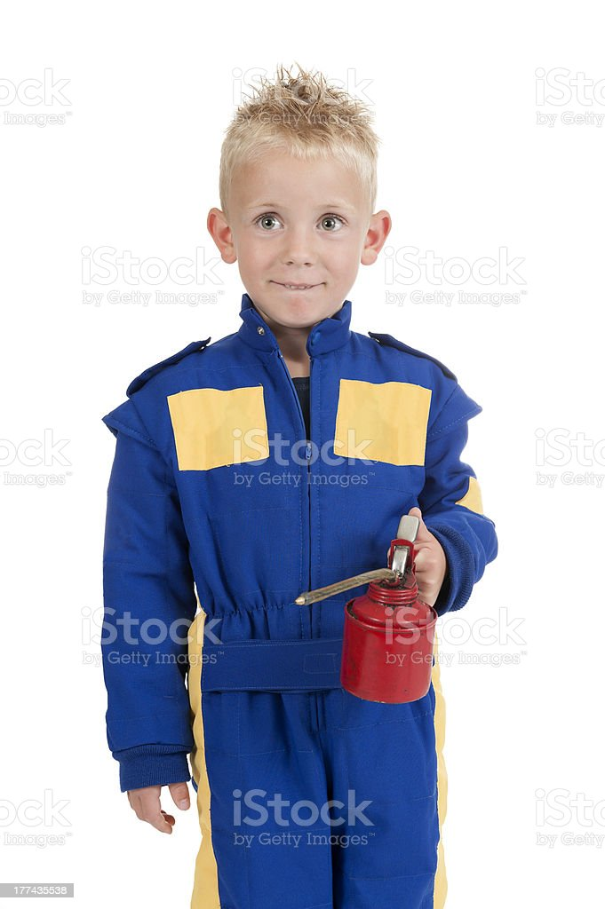 little boy with car service oil pipette royalty-free stock photo