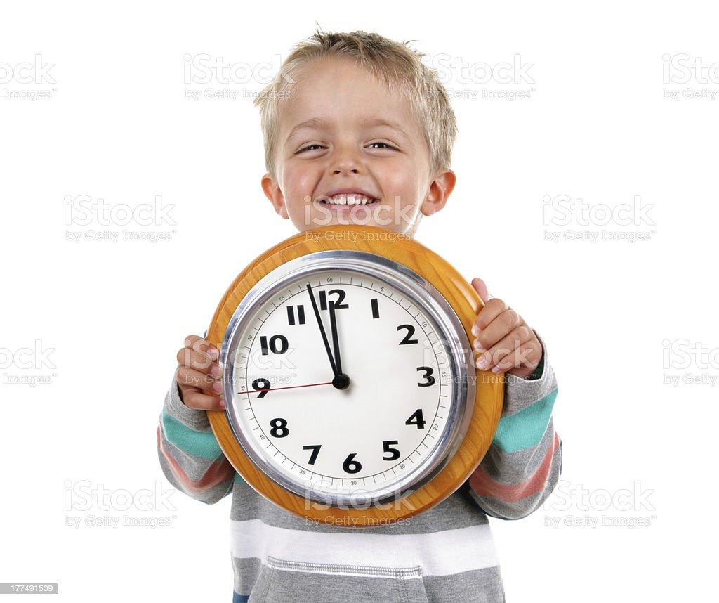 Little boy with clock stock photo